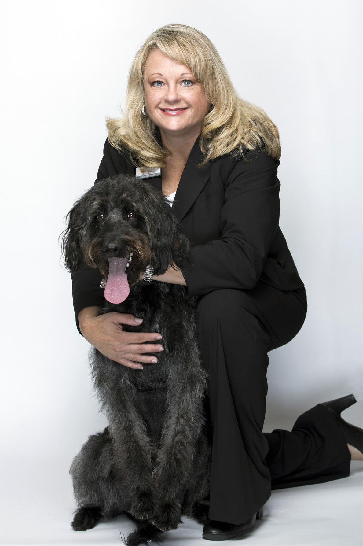 Bella, Our Grief Therapy Dog, pictured with Debbie Hunsaker